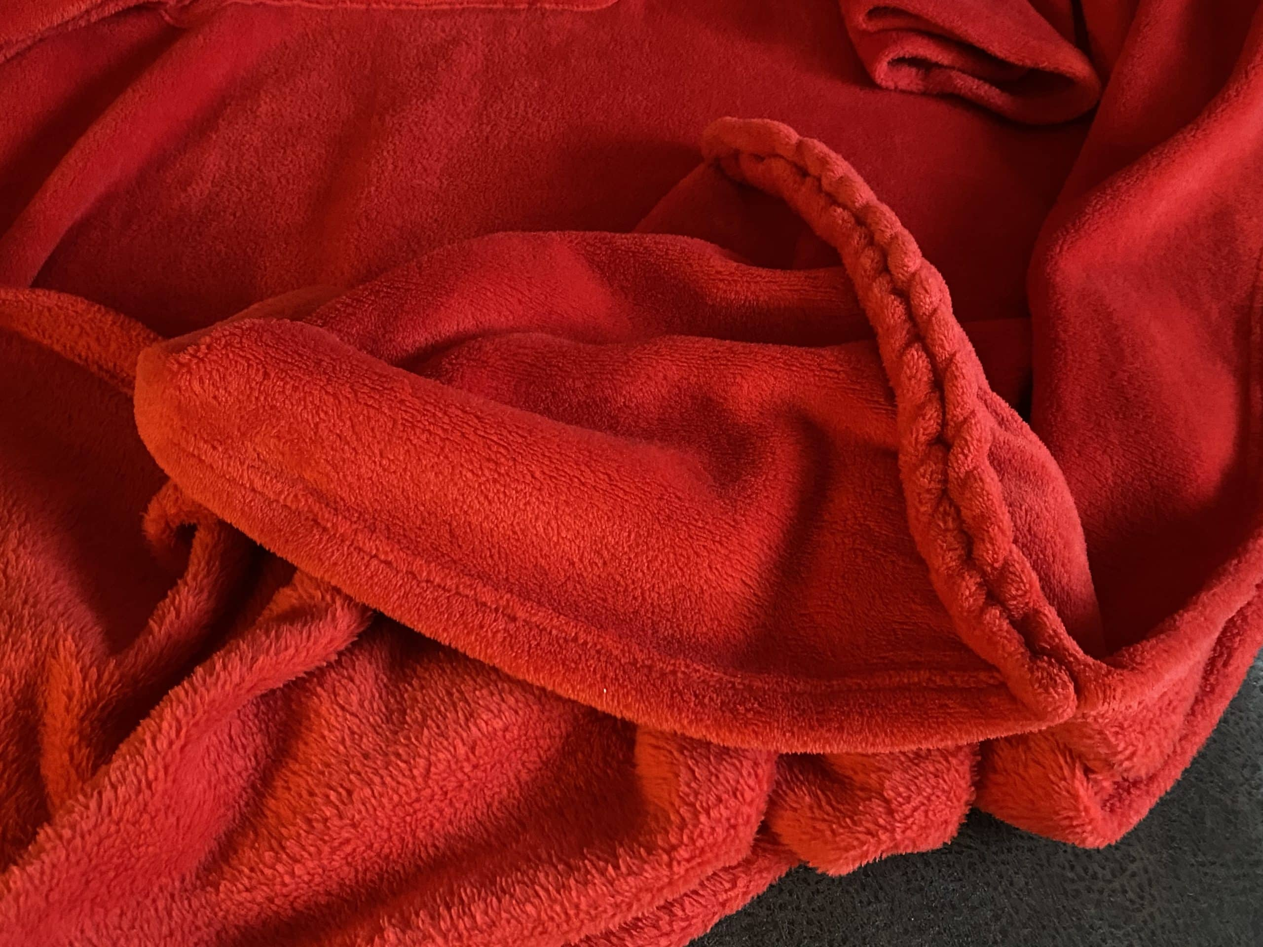 Fußtasche bei der Decke mit Ärmeln